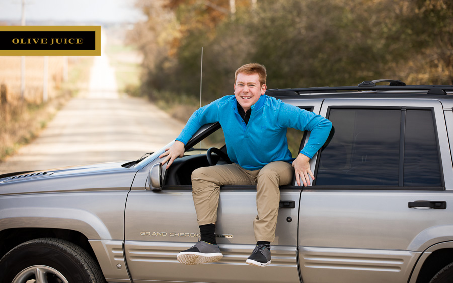 Fun senior photograph with truck Rochester MN | Olive Juice Studios -