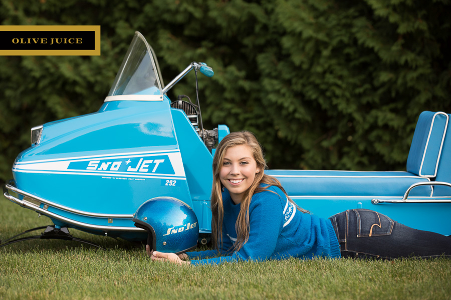 Senior photograph with snowmobile Rochester MN | Olive Juice Studios -
